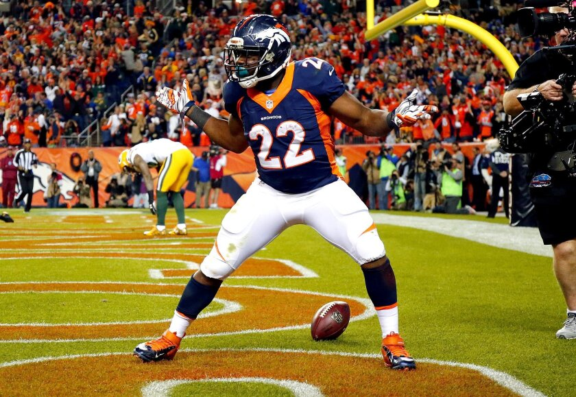Denver Broncos running back C.J. Anderson (22) celebrates his touchdown in the end zone during the second half of an NFL football game against the Green Bay Packers, Sunday, Nov. 1, 2015, in Denver. (AP Photo/Jack Dempsey)