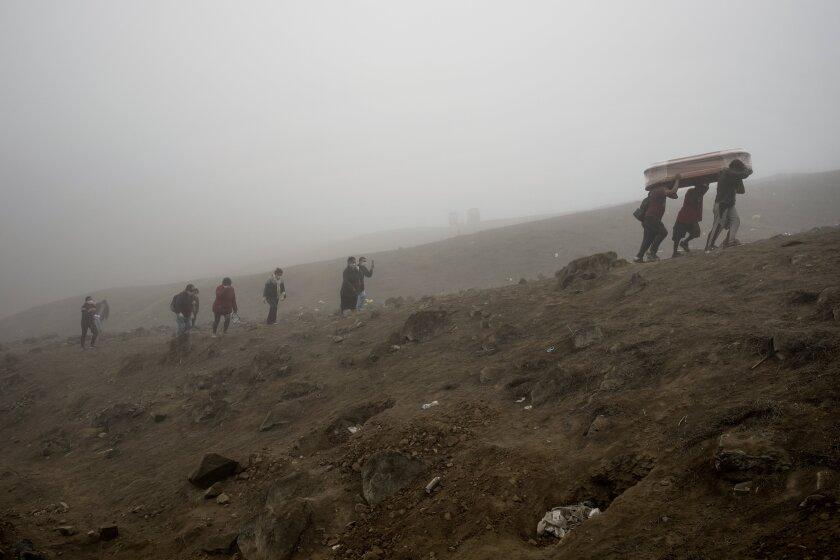 Virus Outbreak Peru Cemetery Photo Gallery