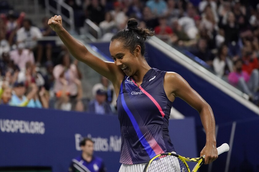 Leylah Fernandez, of Canada, reacts after defeating Angelique Kerber, of Germany.