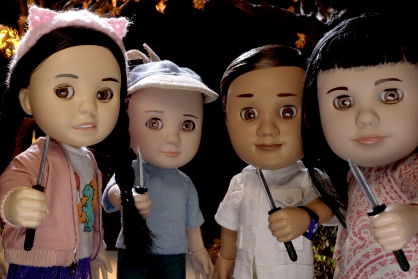 Four baby dolls holding knives
