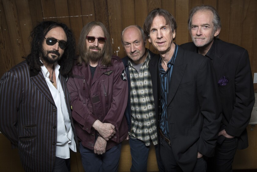 Mudcrutch members are Mike Campbell, left, Tom Petty, Randall Marsh, Tom Leadon and Benmont Tench at Warner Bros. Records in Burbank in April..