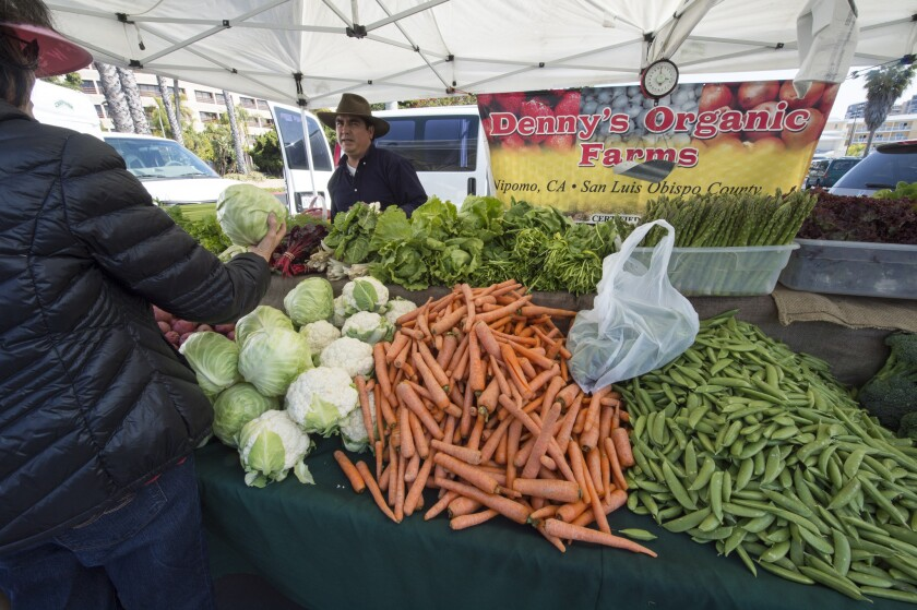 Raul Taborga of Denny's Organic Farm sells vegetables and berries grown in Nipomo, Calif., at the Marina del Rey farmers market.