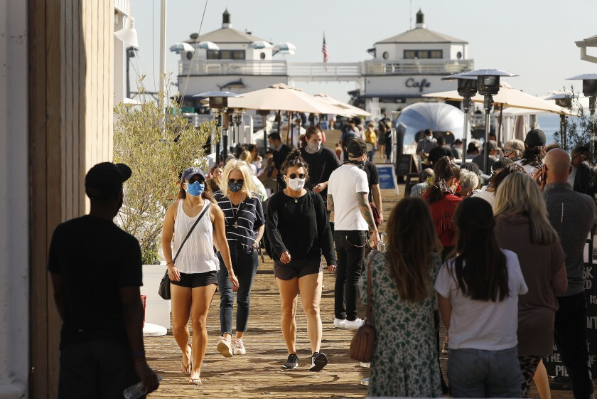 People walk on the Malibu Pier