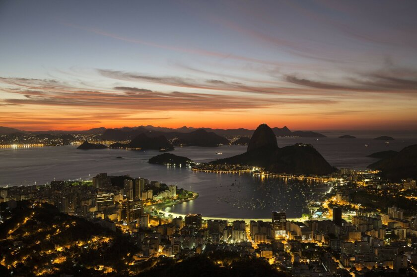 In this April 26, 2016 photo, the sun rises behind Sugar Loaf Mountain in Rio de Janeiro, Brazil. Broadcasters have already deemed the city's backdrop for the Summer Games the most telegenic ever. But no matter how good this teeming seaside metropolis looks on TV, footage simply can't compare with