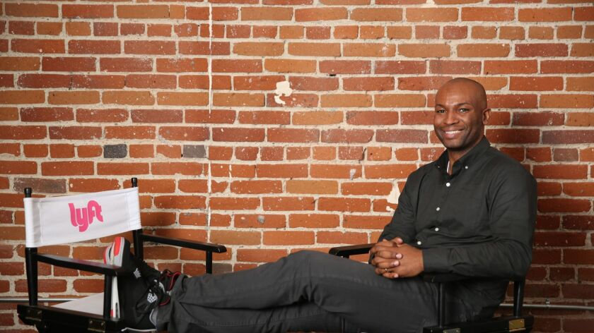 Allen Narcisse, Lyft's Southern California regional director, sits for a portrait at the ride-hailing company's downtown Los Angeles hub.