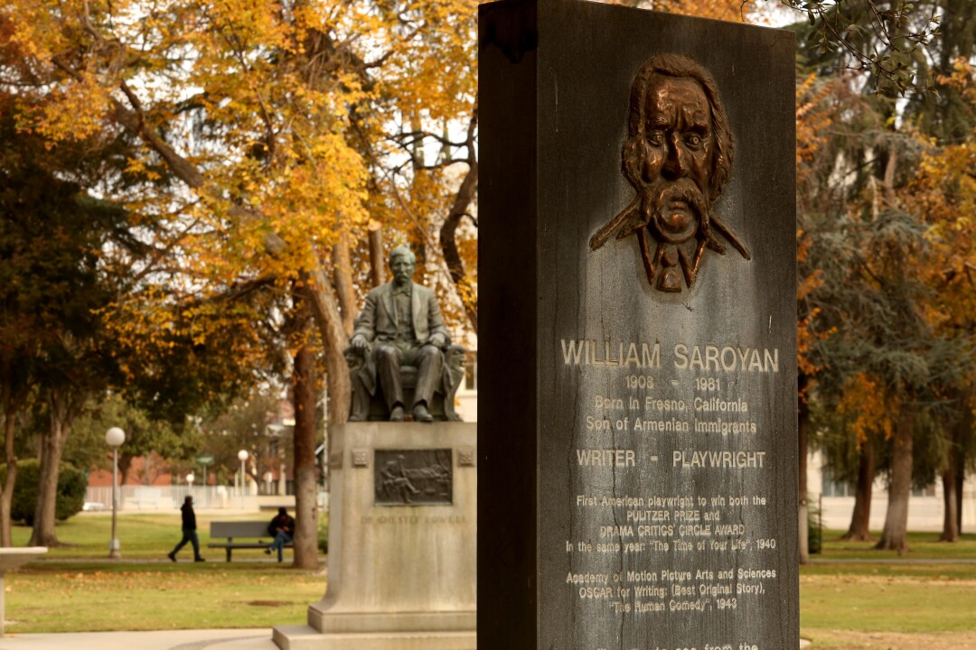 The William Saroyan Monument and Dedicatory Plaque stands in Courthouse Park in downtown Fresno