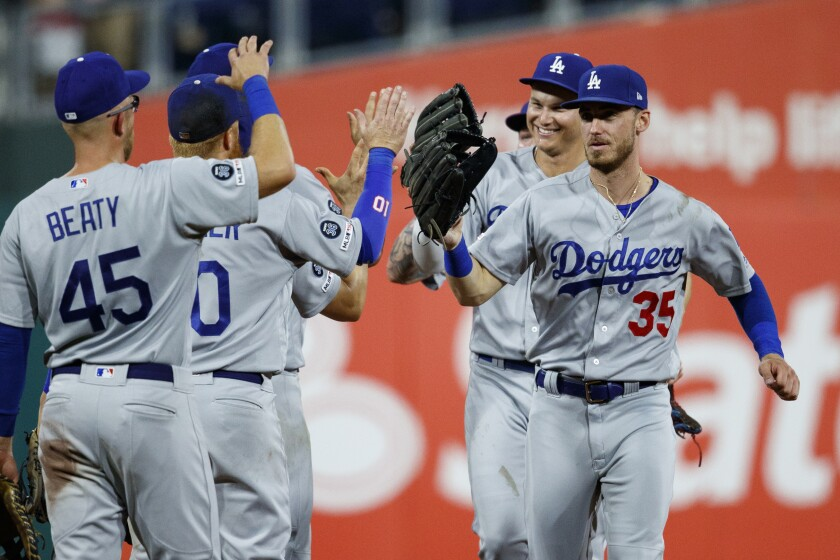 Dodgers' Cody Bellinger, right, celebrates with teammates after beating the Philadelphia Phillies on July 15 in Philadelphia.
