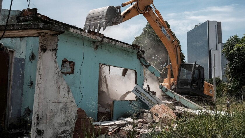 A home is demolished at Vila Autodromo, next to the construction site of the Olympic Park for the Rio 2016 Olympic Games. A passage connecting the Olympic Park with the Athletes Village is planned to be built on the site.