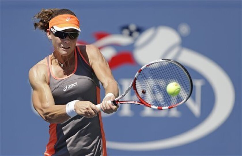 Samantha Stosur, of Australia, returns a shot to Varvara Lepchenko in the third round of play at the 2012 US Open tennis tournament,  Friday, Aug. 31, 2012, in New York. Stosur won the match. (AP Photo/Mike Groll)