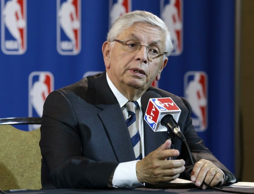 FILE - In this Wednesday, May 15, 2013 file photo, NBA Commissioner David Stern takes a question from a reporter during a news conference following an NBA Board of Governors meeting in Dallas. The NBA says former Commissioner David Stern suffered a sudden brain hemorrhage Thursday, Dec. 12, 2019 and underwent emergency surgery. The league says in a statement its thoughts and prayers are with the 77-year-old Stern's family. (AP Photo/Tony Gutierrez, File)