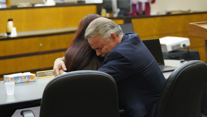 Attorney Keith Greer hugs his client, Mary Zahau-Loehner, after a jury verdict was read in San Diego Superior Court finding Adam Shacknai legally responsible for the death of Rebecca Zahau.