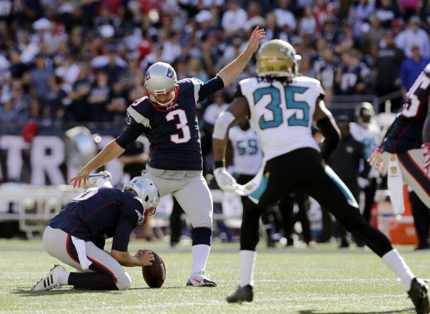 New England Patriots kicker Stephen Gostkowski (3) kicks his 423rd consecutive point after touchdown, to set a new NFL record, in the second half of an NFL football game against the Jacksonville Jaguars, Sunday, Sept. 27, 2015, in Foxborough, Mass. (AP Photo/Charles Krupa)