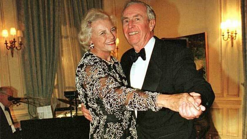 Sandra Day O'Connor dances with her husband, John, in 1998 at the annual Meridien Ball in Washington, D.C.