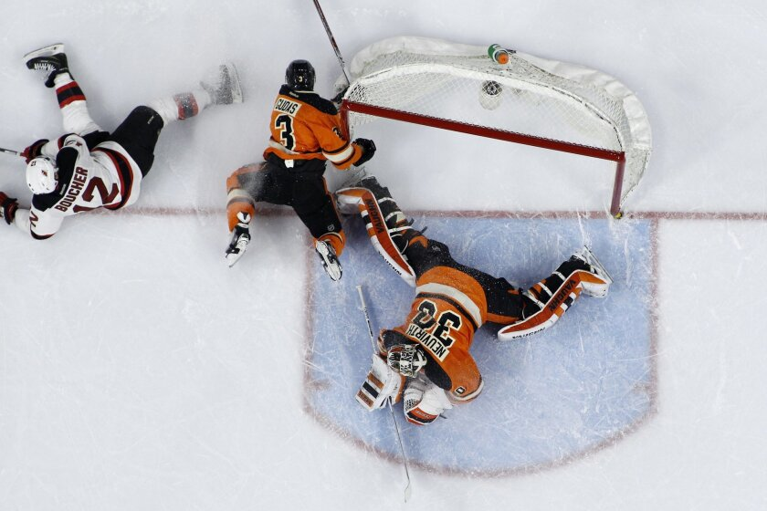 Philadelphia Flyers' Radko Gudas (3) collides with the net after blocking a shot by New Jersey Devils' Reid Boucher (12) against Michal Neuvirth (30) during the third period of an NHL hockey game, Saturday, Feb. 13, 2016, in Philadelphia. New Jersey won 2-1 in overtime. (AP Photo/Matt Slocum)