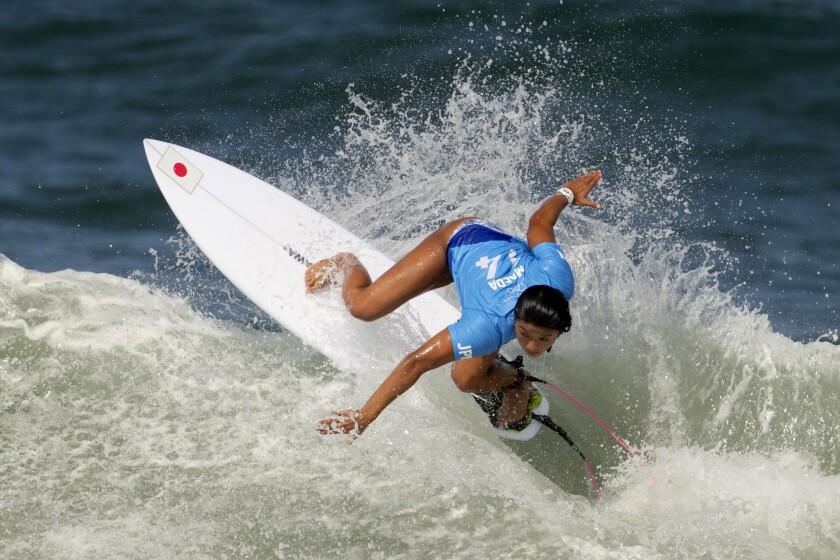 Japan's Mahina Maeda maneuvers on a wave during the second round of the women's surfing at the 2020 Summer Olympics, Sunday, July 25, 2021, at Tsurigasaki beach in Ichinomiya, Japan. (AP Photo/Francisco Seco)