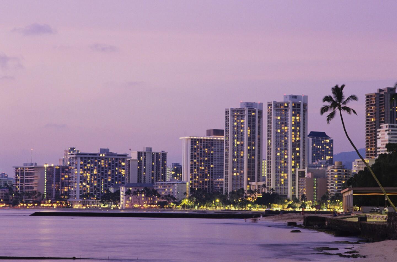 Honolulu, Waikiki hotels at dusk.