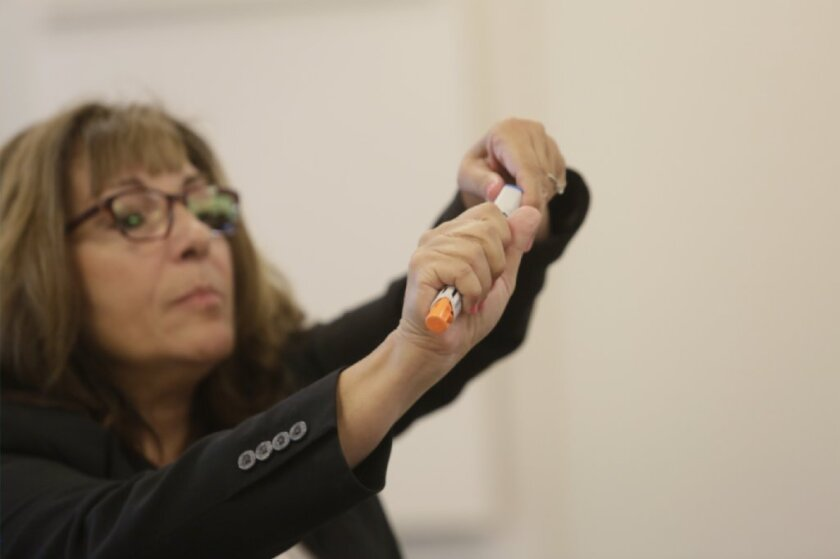 A trainer in the Michigan schools instructs teachers and other staff on how to use an epinephrine auto-injector. Michigan was ahead of California in stocking the life-saving devices in schools and training staff to use them in an emergency.