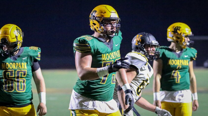 Moorpark offensive lineman Jonah Monheim watches a play against Newbury Park on Nov. 1, 2019.