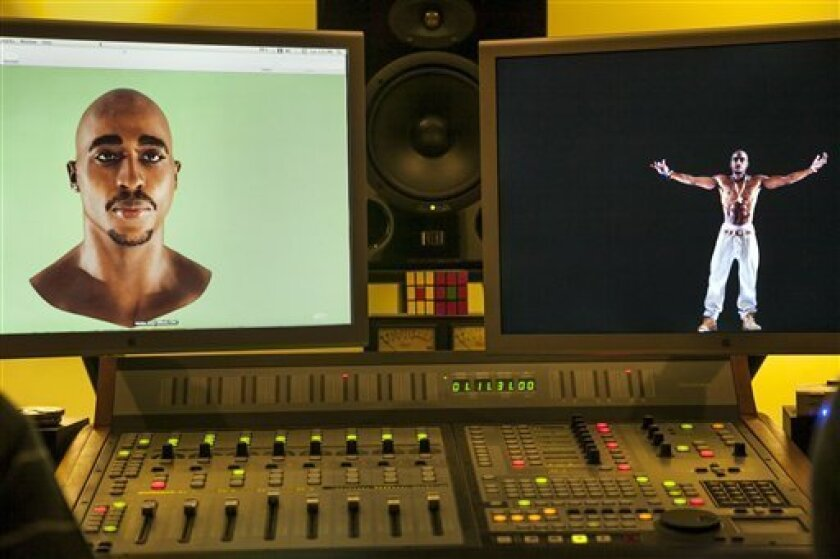 In this photo taken Tuesday, June 12, 2012, video images of the Tupac Shakur hologram are displayed on a computer monitor at the Subtractive Studio in Santa Monica, Calif. When Tupac Shakur rose from the stage in the California desert earlier this year, it was not only a jaw-dropping resurrection,