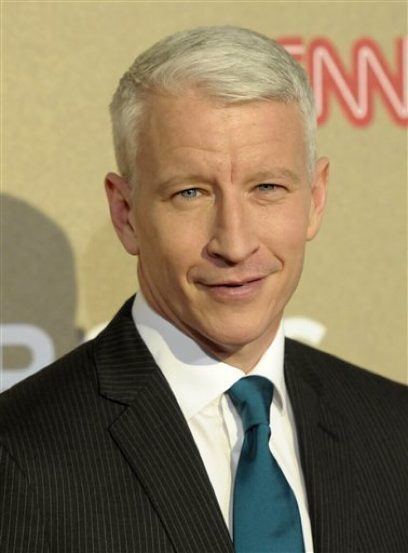 "FILE - In this Sunday, Dec. 2, 2012 file photo, reporter Anderson Cooper arrives at CNN Heroes at The Shrine Auditorium in Los Angeles. Cooper says a reporting assignment turned into a temporary blindness scare. On his talk show Tuesday, Dec. 4, Cooper said he was in Portugal last week working on a story for ""60 Minutes,"" spent two hours on the water and then suffered a 36-hour loss of sight. (Photo by Dan Steinberg/Invision/AP, File)"