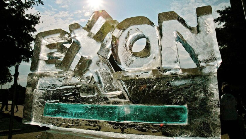An ice sculpture fashioned by protesters, in demonstration of how the company's policies are affecting the environment, slowly melts in Dallas, Texas on May 31, 2006.