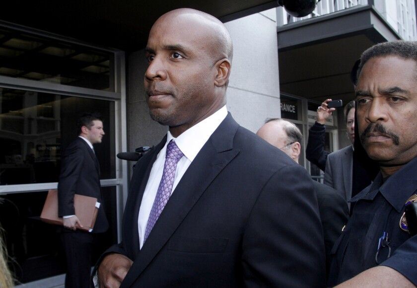 Barry Bonds leaves court during his trial in 2011.