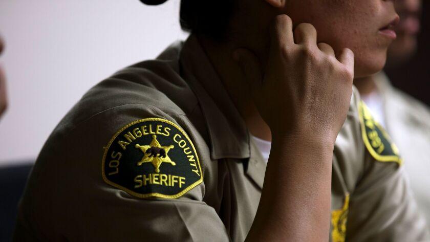 A female deputy listens during de-escalation training for Los Angeles County Sheriffs Department (LA