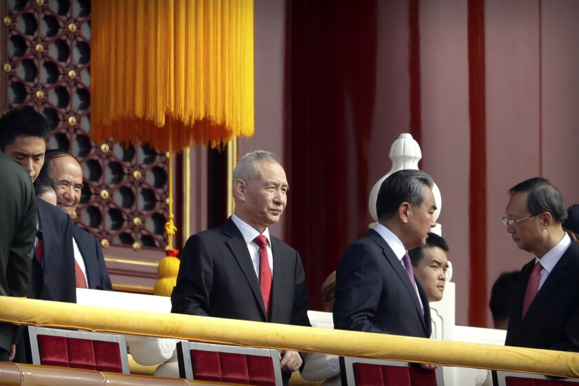 In this Oct. 1, 2019, photo, Chinese Vice Premier Liu He, center, stands on Tiananmen Gate near Tiananmen Square with other leaders before a parade to commemorate the 70th anniversary of the founding of Communist China. Liu will lead a delegation that includes China's commerce minister and central bank governor and industry, technology and agriculture regulators to Washington on Thursday for talks aimed at ending a tariff war, the Ministry of Commerce said Tuesday, Oct. 8, 2019. (AP Photo/Mark Schiefelbein)