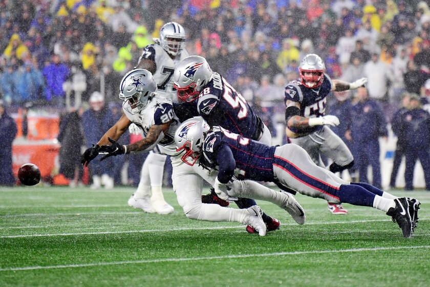 Dallas' Tony Pollard is unable to catch a pass while covered by New England's Jamie Collins Sr. (58) and Dont'a Hightower (54).