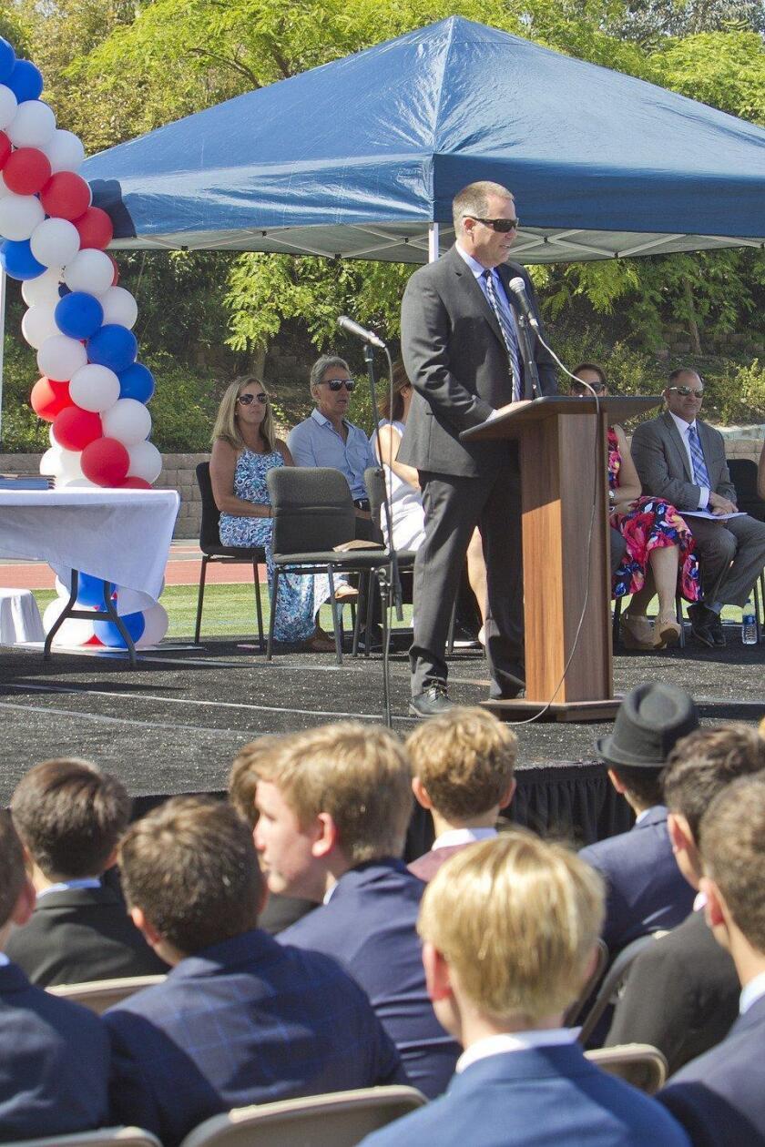 R. Roger Rowe Middle School principal Garrett Corduan makes opening remarks
