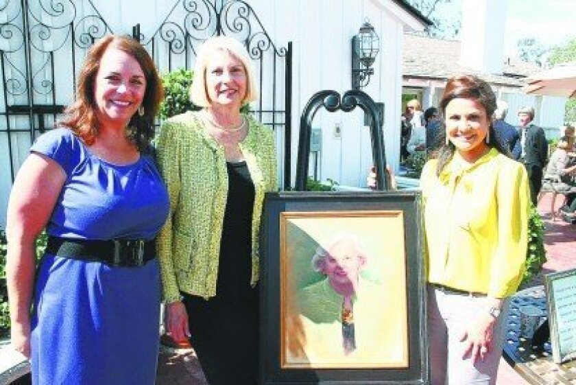 Country Friends President Rhonda Tryon (left) and consignment shop manager Yvette Letourneau (right) presented a portrait of Jean to her daughter Suzanne (center).  Photo/Karen Billing