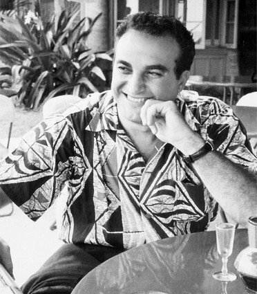 Alfred Shaheen is seen here in a Samoan Tapa in 1954. Shaheen sold prints for men's shirts and shorts and women's dresses and sarongs. Shaheen died Dec. 22 at 86.