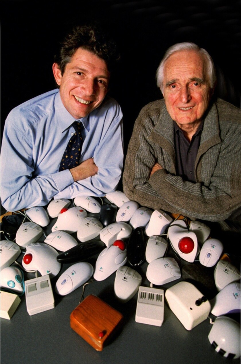 Doug Engelbart, right, inventer of the computer mouse is seen with Guerrino De Luca, president and CEO of Logitech, in 1998.