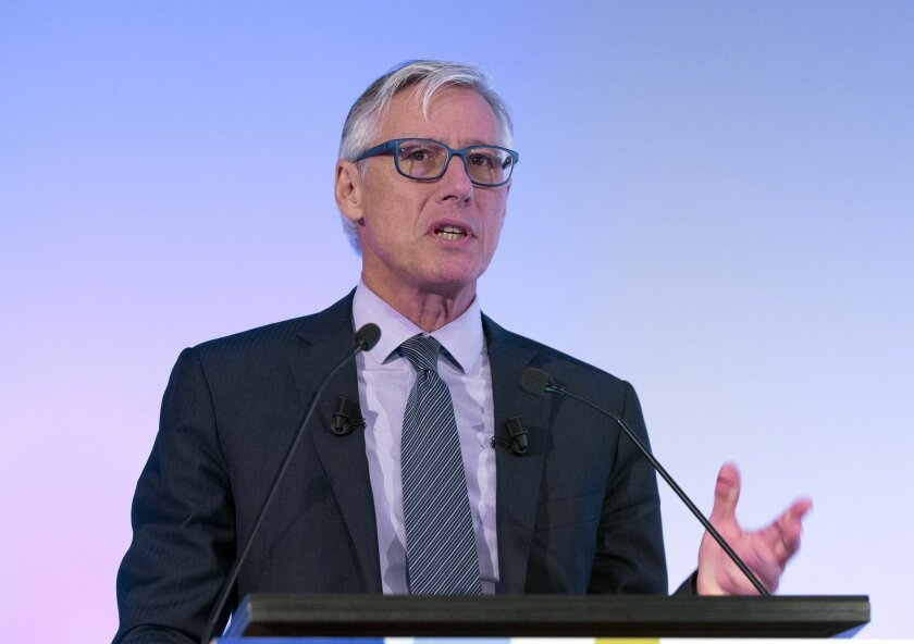 French drug maker Sanofi CEO Olivier Brandicourt  presents the company's 2015 full year results in Paris, Tuesday  Feb. 9, 2016.  Sanofi says its bottom line was roughly stable last year as it advanced efforts to reshape its drug portfolio and pursue research and development tie-ups in oncology and