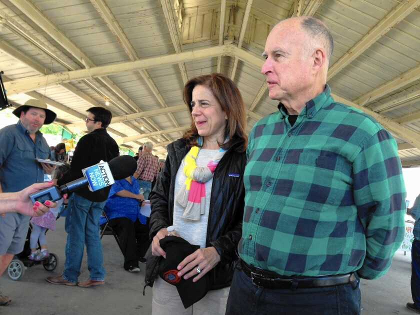 Gov. Jerry Brown and his wife, Anne Gust, make the rounds at the western festival in Colusa, where they helped judge a cooking contest.