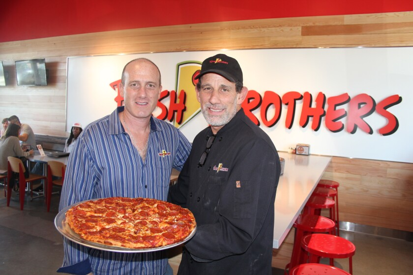 Adam and Scott Goldberg, the Fresh Brothers, at the new store in the Village at Pacific Highlands Ranch.