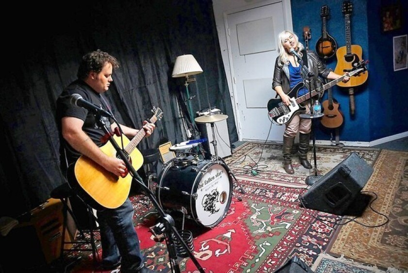 """Bobbo and Tracy Byrnes of the Fallen Stars jam at their recording studio in Westminster. The pair will be performing songs based on the sci-fi show """"Firely"""" during the """"Can't Stop the Serenity"""" benefit to support Equality Now, which takes place on Sept. 21."""