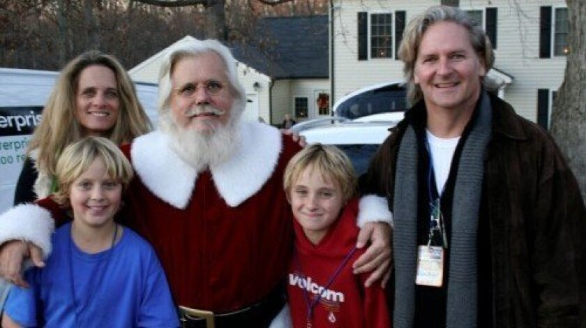 "The Meader family takes a break from production of ""Extreme Makeover: Home Edition"" during their visit to Lincolnton, N.C., at a home near the one featured on the ABC show. Joining Santa are Kim and Will to his left and John and Dan to his right. Courtesy photo"