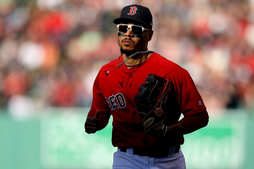 Mookie Betts returns to the dugout against the Baltimore Orioles on Sept. 29, 2019, in Boston.