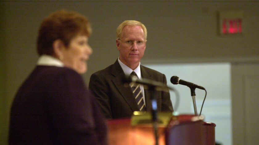 Then-District Attorney Paul Pfingst is shown at a July 2002 debate with his challenger, Bonnie Duman