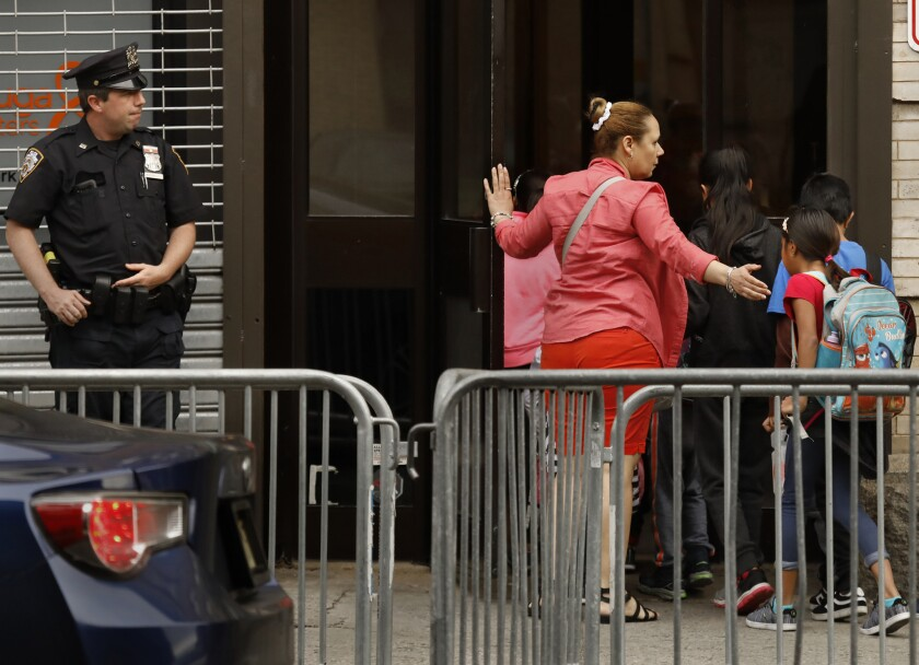 HARLEM, NEW YORK--JUNE 27, 2018-- A group of children are taken to the Cayuga Center in East Harlem.