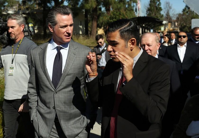 LOS ANGELES, CA-FEBRUARY 19, 2019: Gov. Gavin Newsom, center left, and Mayor Robert Garcia, right, t