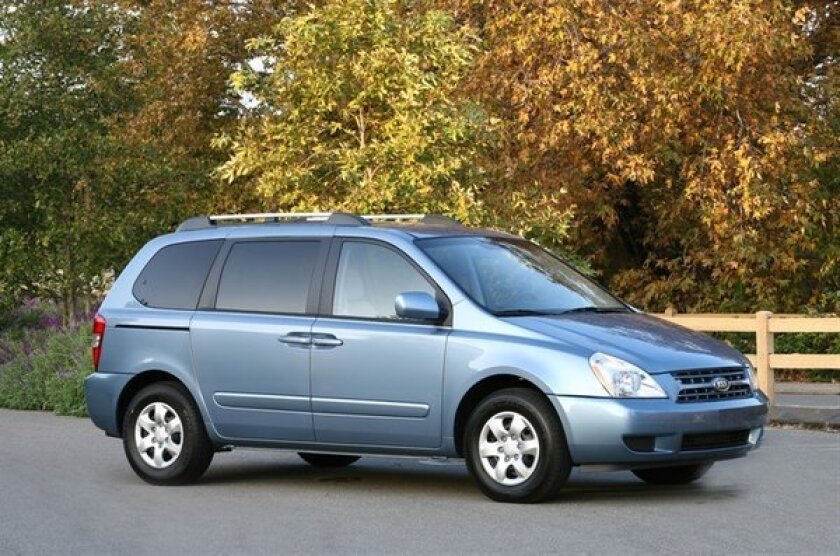 Kia is recalling nearly 80,000 Sedona minivans -- like the 2009 model seen here -- to fix a corrosion issue in the front suspension. The recall affects the 2006-2012 model years.