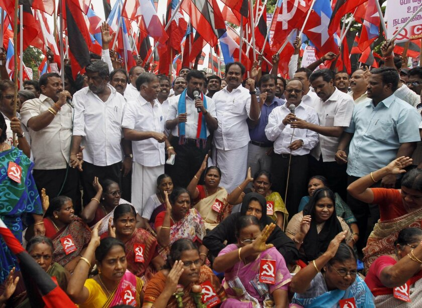 Members of Communist Party of India and Liberation Panthers participate in a protest in Chennai, India, Tuesday, Nov. 3, 2015. An international rights group on Tuesday demanded the release of an Indian folk singer arrested S. Kovan on charges including sedition for writing songs criticizing a state