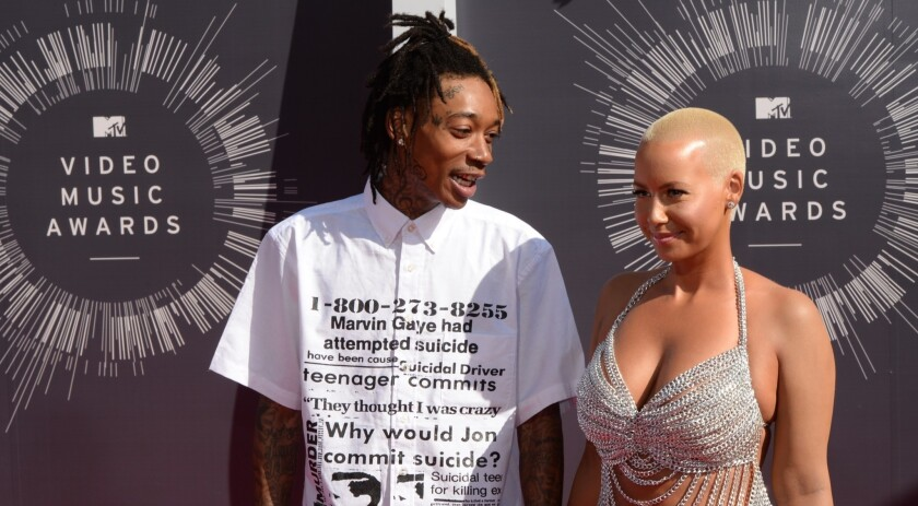 Wiz Khalifa and Amber Rose arrive on the red carpet at the MTV Video Music Awards at the Forum in Inglewood on Aug. 24.