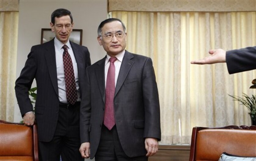 Robert Einhorn, left, U.S. State Department's special adviser for nonproliferation and arms control, and chief South Korean nuclear envoy Wi Sung-lac arrive for their talk at the latter's office at the foreign ministry in Seoul, South Korea Wednesday, March 2, 2011. (AP Photo/Lee Jae-won, Pool)