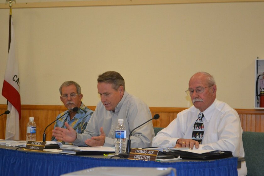 RMWD Director Jim Hickle, center, asks questions regarding fire EDU fees as Director George Foote, left, and Director Thomas Ace listen.