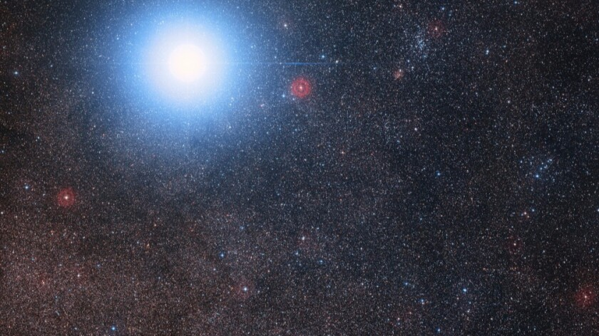 The sky around the bright star pair Alpha Centauri AB also shows the much fainter red dwarf star, Proxima Centauri, the closest star to our solar system.
