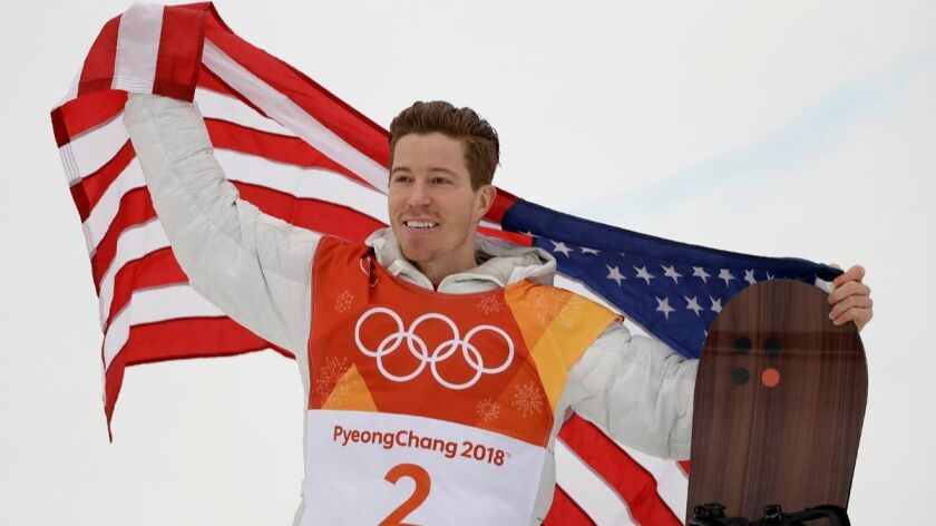 Shaun White celebrates his gold medal after the men's halfpipe finals at Phoenix Snow Park at the 2018 Winter Olympics in Pyeongchang, South Korea on Wednesday.