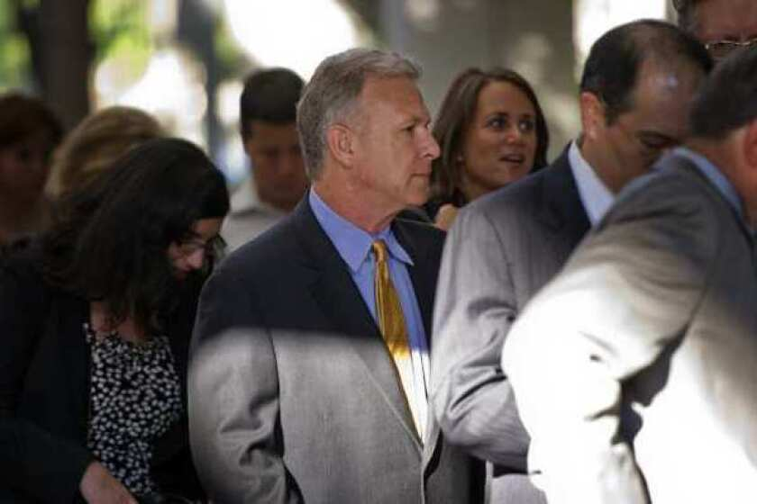 Phil Schiller, Apple's senior vice president of worldwide marketing, waits to enter the San Jose courthouse where the Apple-Samsung patent-infringement trial is being held.